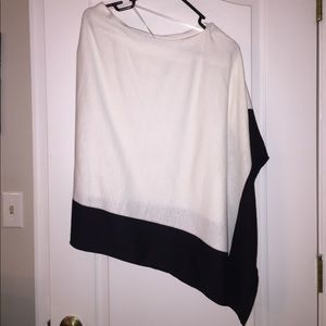 Black and white asymmetrical cape. Never been worn